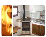 Cucina a legna senza forno disposta ad angolo, color sabbia. Installata a Casiacco (PN).